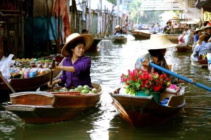 two-women-floating-market-sellers-damnoen-saduak-thailand